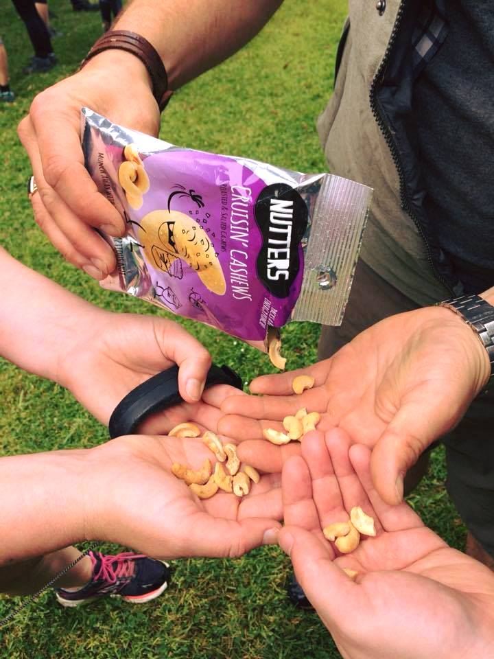 People snacking on fruit and nuts
