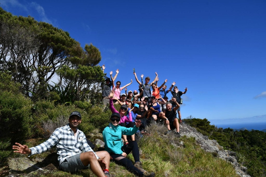 Group posing for photo on Great Barrier Island