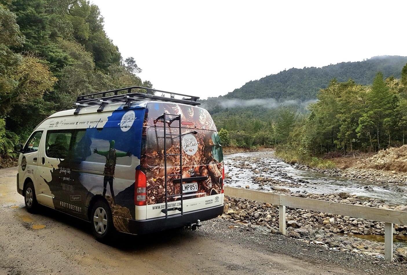 adventure van next to river nz